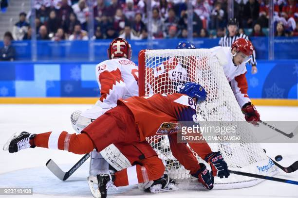 TOPSHOT Czech Republic's Tomas Mertl falls in front of the net in the men's semifinal ice hockey match between the Czech Republic and the Olympic...