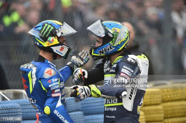Czech rider Karel Abraham and Spanish rider Joan Mir argue after crashing during the training tour of the MotoGP race of the French Motorcycle Gand...