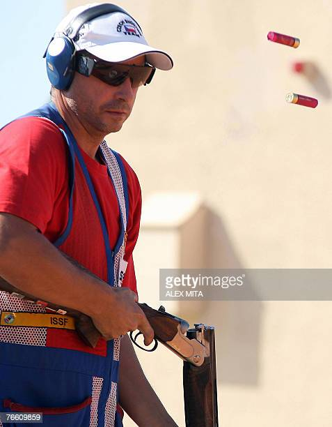Czech shooter Leos Hlavacek discards his spent cartridges after shooting during the men's skeet final of the ISSF World Shooting Championships in...
