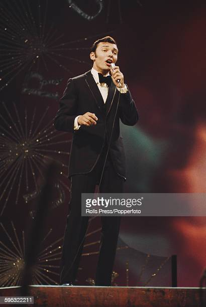 Czech singer Karel Gott performs the song 'Tausend Fenster' on stage for Austria in the Eurovision Song Contest at the Royal Albert Hall in London on...
