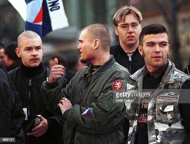 Czech skinheads attend a rally by the farright Republican party in Prague March 13 held in commemoration of the 60th anniversary of the Nazi...