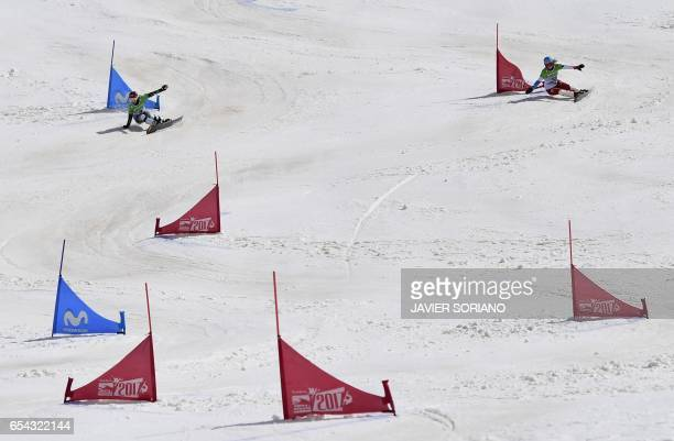 Czech snowboarder Ester Ledecka and Swiss snowboarder Patrizia Kummer compete during the women's Parallel Giant Slalom PGS grand final at the 2017...