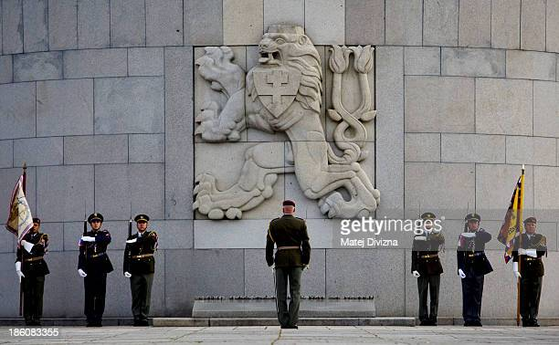 Czech soldiers stand in front of the National Memorial during an Independence Day ceremony at Vitkov Hill on October 28 2013 in Prague Czech Republic...
