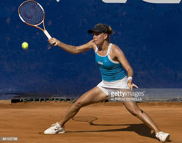 Czech tennis player Barbora Zahlavova returns the ball to Spanish tennis player Carla Suarez during their Open tennis match, in Acapulco, Mexico, on...