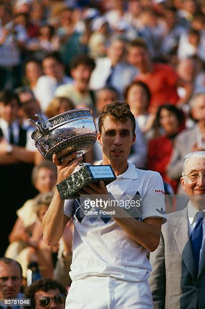 Czech tennis player Ivan Lendl with the trophy after winning the men's singles final of the Tournoi de Roland-Garros , at the Stade Roland Garros,...