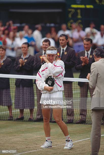 Czech tennis player Jana Novotna pictured crying as she holds the runner's up dish after being defeated by Steffi Graf in the final of the Ladies'...