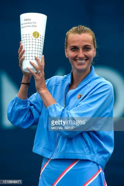 Czech tennis player Petra Kvitova poses with the trophy after she defeated her compatriot Karolina Muchova in the final tennis match of the Czech...