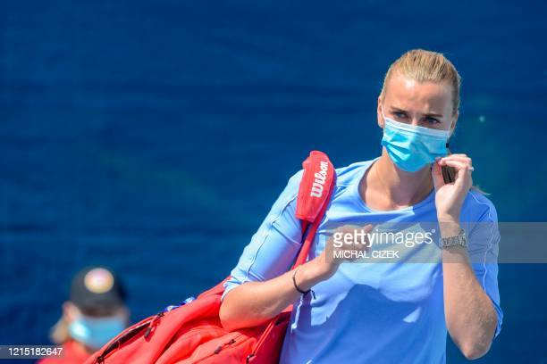 Czech tennis player Petra Kvitova wears a face mask as she arrives to play a match of the Czech Tennis Association President's Cup on May 26 2020 in...