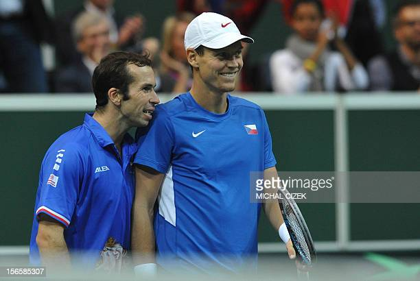 Czech tennis player Radek Stepanek and Tomas Berdych smile during their double tennis match against Spanish tennis players Marc Lopez and Marcel...