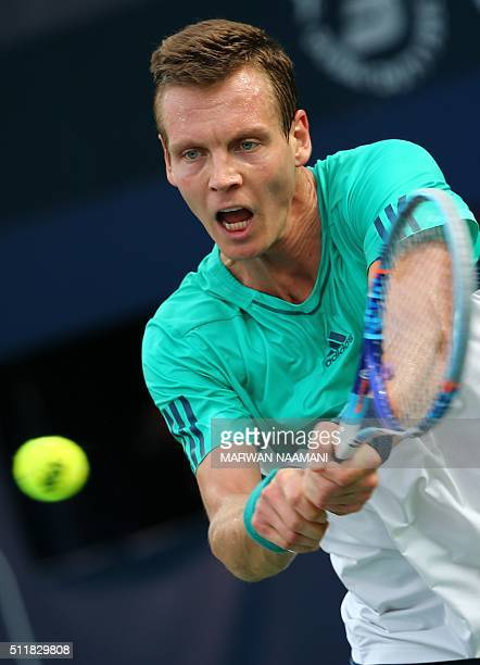 Czech tennis player Tomas Berdych returns the ball to Portuguese Joao Sousa during their ATP tennis match on the second round of the Dubai Duty Free...