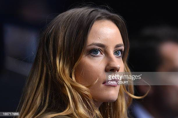 Czech tennis player Tomas Berdych's girlfriend Ester Satorova watches Berdych play France's JoWilfried Tsonga during their group A singles match in...