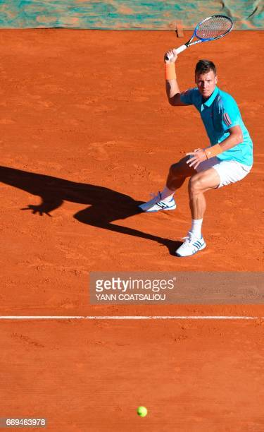 Czech Tomas Berdych hits a return to Russia's tennis player Andrey Kuznetsov during the Monte-Carlo ATP Masters Series tournament on April 17, 2017...