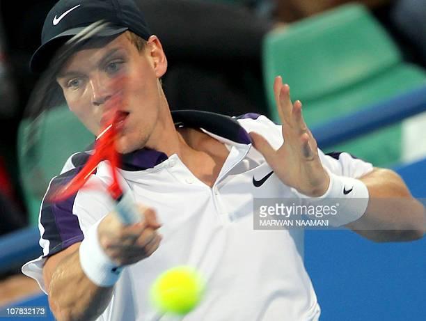 Czech Tomas Berdych returns the ball to world number one Spanish Rafael Nadal during their Mubadala World Tennis Championship semifinal match in Abu...