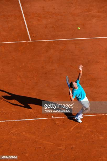 Czech Tomas Berdych serves to Russia's tennis player Andrey Kuznetsov during the Monte-Carlo ATP Masters Series tournament on April 17, 2017 in...