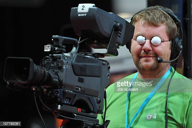 Czech TV cameraman jokes during the match between Germany's Timo Boll and Patrick Baum during men's singles final match of European Table Tennis...
