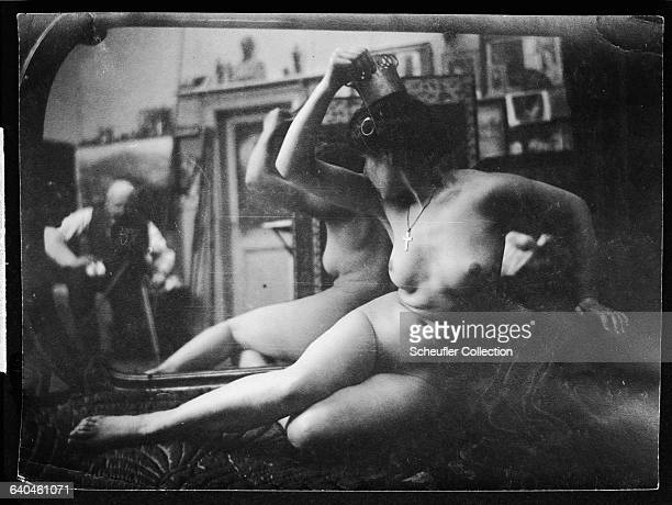 A Czech woman poses nude for a photogrpaher