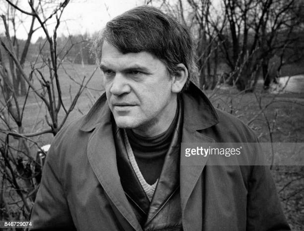 Czech writer Milan Kundera poses in a garden in Prague 14 October 1973 Novelist born in Brno Czech Republic Kundera lectured in Cinematographic...