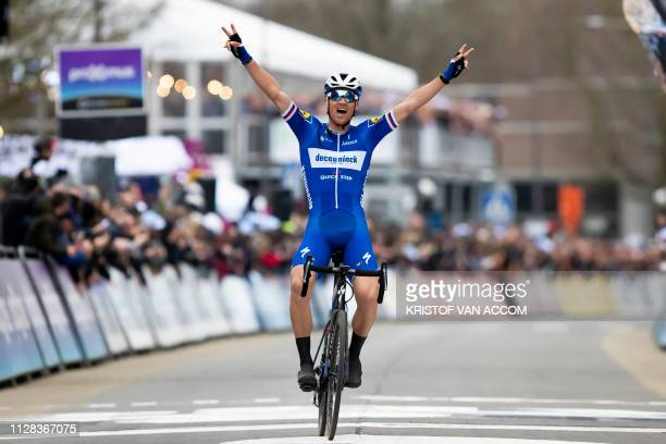 Czech Zdenek Stybar celebrates as he crosses the finish line to win the men's race of 74th edition of the oneday cycling race 'Omloop Het Nieuwsblad'...