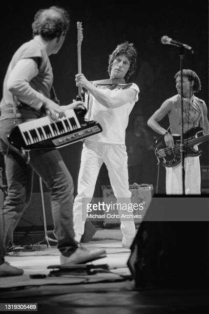 Czech-American musician and composer Jan Hammer playing keyboards supported on a shoulder strap, British guitarist and songwriter Jeff Beck, wearing...