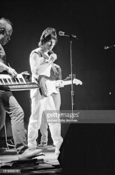 Czech-American musician and composer Jan Hammer playing keyboards supported on a shoulder strap, and British guitarist and songwriter Jeff Beck,...