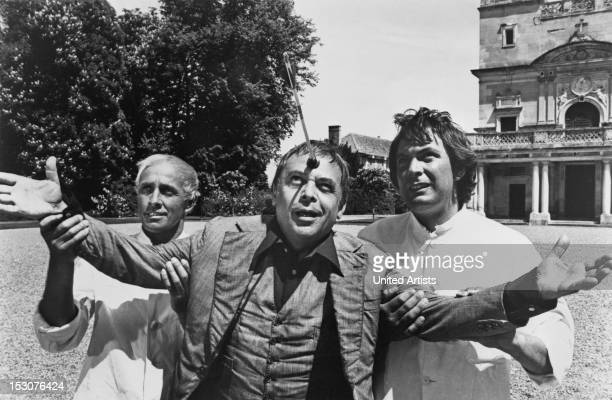Czechborn actor Herbert Lom as the deranged Dreyfus being restrained by two asylum orderlies in the film 'The Pink Panther Strikes Again' 1976