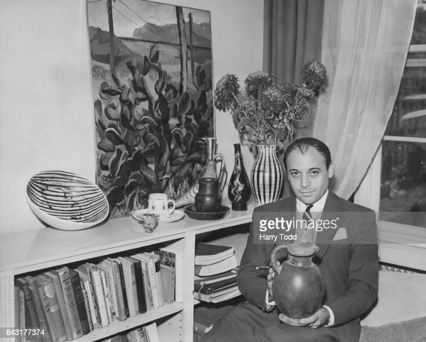 Czechborn British actor and collector of antiques Herbert Lom holding an Etruscan jug from the 5th century BC at his flat in Kensington London 25th...
