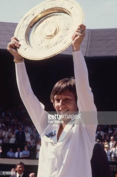 Czechborn tennis player Martina Navratilova wins the Wimbledon women's singles trophy for the second consecutive year after beating Chris Evert Lloyd...