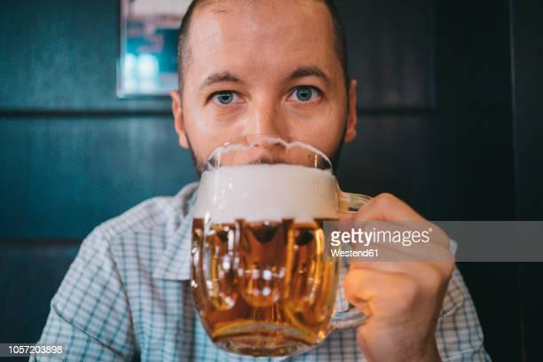 Czechia, portrait of man drinking beer in a pub