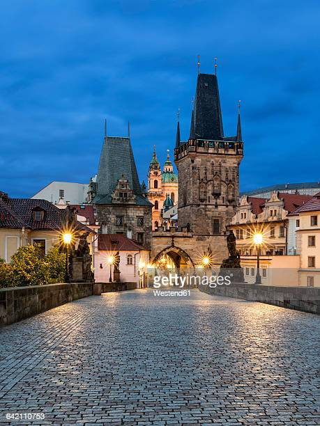czechia, prague, charles bridge in the evening - charles bridge stock photos and pictures