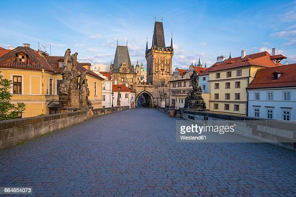czechia, prague, old town, kleinseite bridge tower in the evening - charles bridge stock pictures, royalty-free photos & images