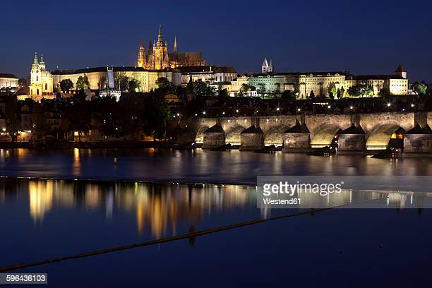 Czechia, Prague, view to lighted Prague Castle and Charles Bridge at night