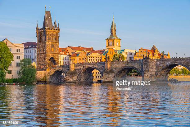czechia, prague, vltava river, old town with charles bridge with bridge tower, water tower of old mill in the background - vltava river stock pictures, royalty-free photos & images