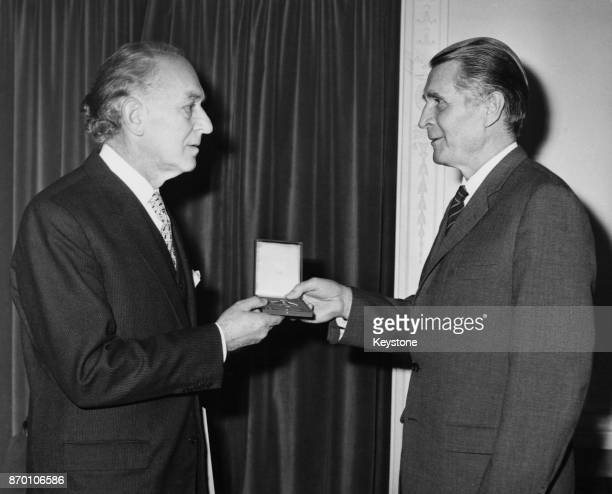 Czechoslovak art historian Josef Paul Hodin receives Germany's Order of Merit, the Verdienstkreuz, First Class, from Erwin Wickert , Chargé...