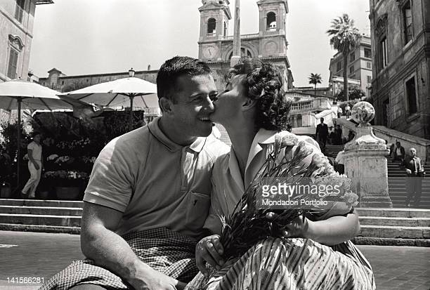 Czechoslovak athlete Olga Fikotova kissing her husband American athlete Harold Connolly at the Rome Olympic Games Rome August 1960