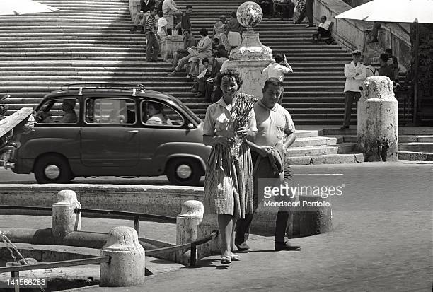 Czechoslovak athlete Olga Fikotova strolling with her husband American athlete Harold Connolly at the Rome Olympic Games Rome August 1960