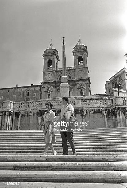 Czechoslovak athlete Olga Fikotova strolling with her husband American athlete Harold Connolly at Trinita dei Monti during the Rome Olympic Games...