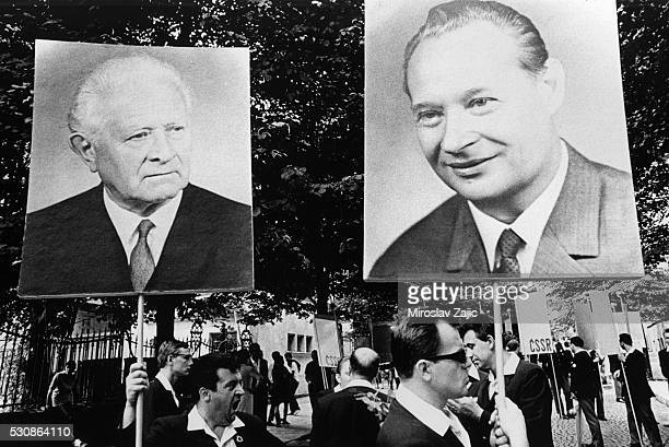 Czechoslovak participants in the Sofia Youth and Student Festival carry posters of President Svoboda and First Secretary Dubcek