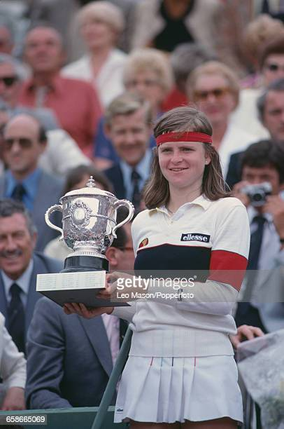 Czechoslovak tennis player Hana Mandlikova pictured raising the trophy in the air in celebration after defeating Sylvia Hanika 62 64 in the final of...