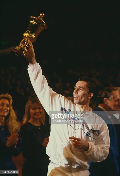 Czechoslovak tennis player Ivan Lendl holds up the Benson Hedges Championships Trophy after defeating Anders Jarryd in the final of the Men's Singles...