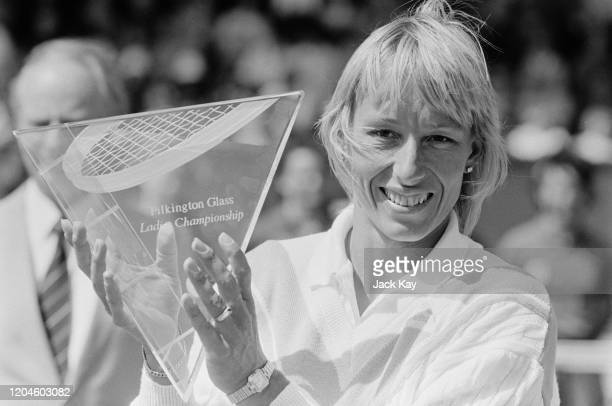 Czechoslovak-born American former professional Martina Navratilova holding her trophy after winning at the Pilkington Glass Championships at the...
