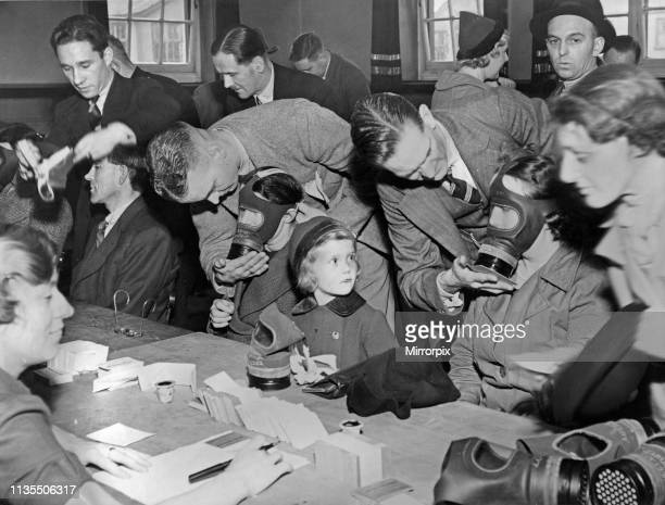 Czecho-Slovakia Crisis ARP measures taken in Liverpool as members of the public seen here receiving their gas masks at an un-named school 27th...