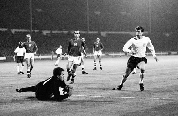 Czechoslovakia goalkeeper Ivo Viktor gathers the ball as England striker Geoff Hurst runs in, during the friendly International at Wembley Stadium in...