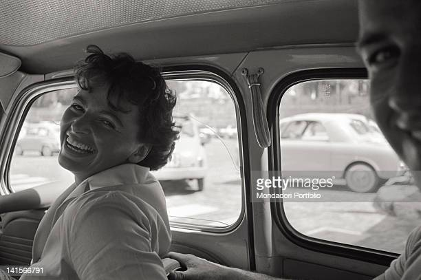 Czechoslovakian athlete Olga Fikotova smiling on board car with the American athlete Harold Connolly her husband Rome 1960