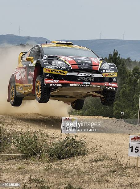 Czechoslovakian driver Martin Prokop and his compatriot copilot Jan Tomanek jump their Ford Fiesta RS WRC as they compete during the fourth special...