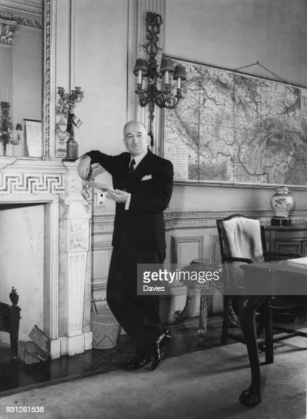 Czechoslovakian leader in exile Dr Edvard Benes at his home in London with a map of Czechoslovakia behind him 1944