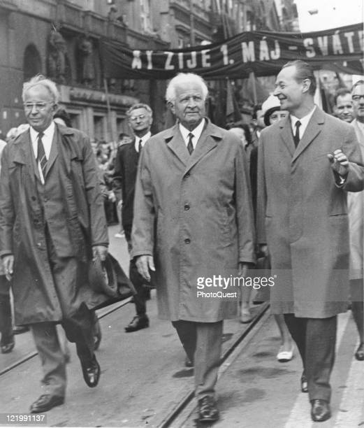 Czechoslovakia's Alexander Dubcek Communist Party leader smiles as he marches with President Ludvik Svoboda and Party chieftobe Gustav Husak in...