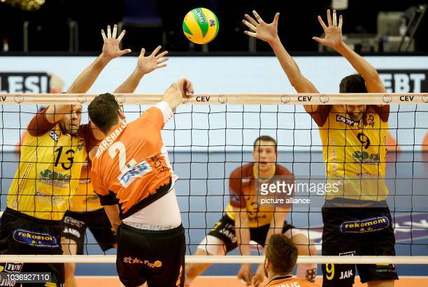 Czech's Adrian Patucha and Jakub Vesely alongside Berlin's Steven Marshall in action during the men's 4th round Group B match between Berlin Volleys...