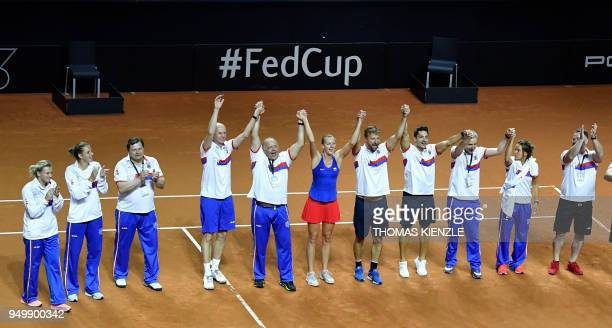 Czech's FedCup team with Petra Kvitova celebrate after her victory against Germany's Angelique Kerber during the tennis FedCup World Group semifinal...