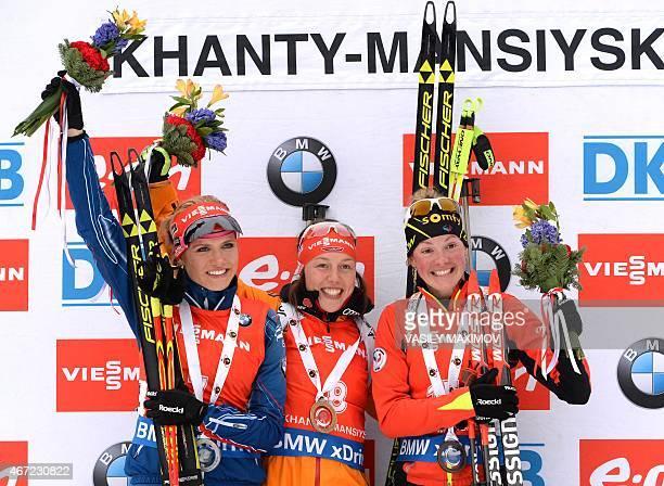 Czech's Gabriela Soukalova Germany's Laura Dahlmeier and France's Marie Dorin Habert celebrate on the podium after the women's 125 km mass start...