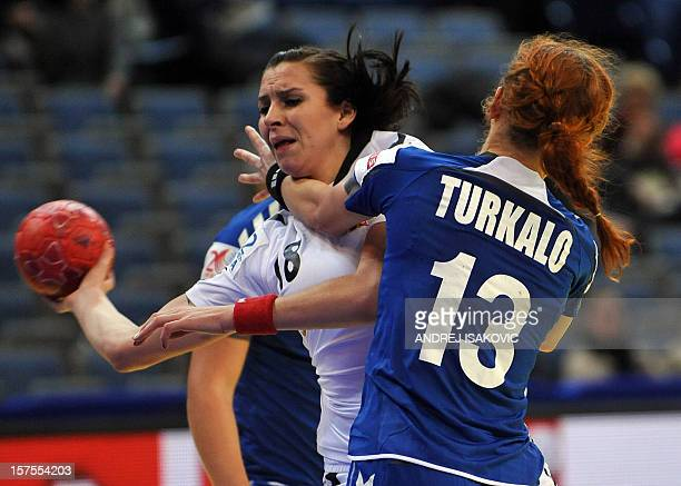 Czech's Iveta Luzumova vies with Ukraine's Natalya Turkalo during the Women's Euro 2012 handball championship match Ukraine vs Czech Republic on...